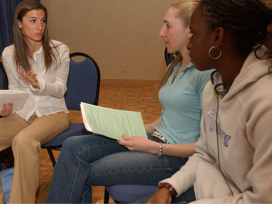An AHA Trainer Working With Student Athletes